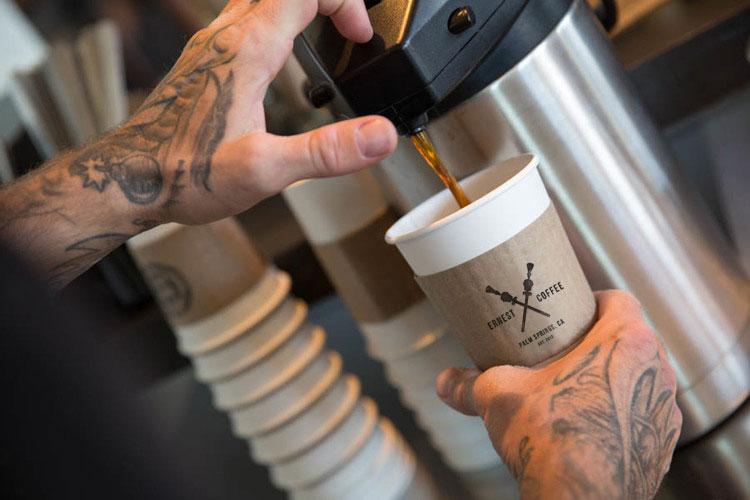 Server making a coffee